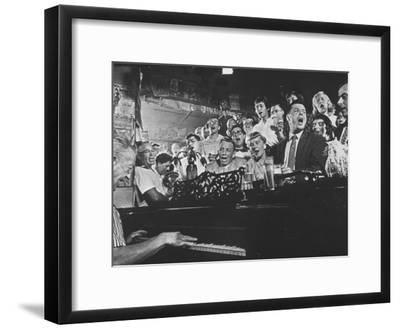 Customers at Bar of Casey's Limestone House Join in Singing Old Songs-Yale Joel-Framed Premium Photographic Print