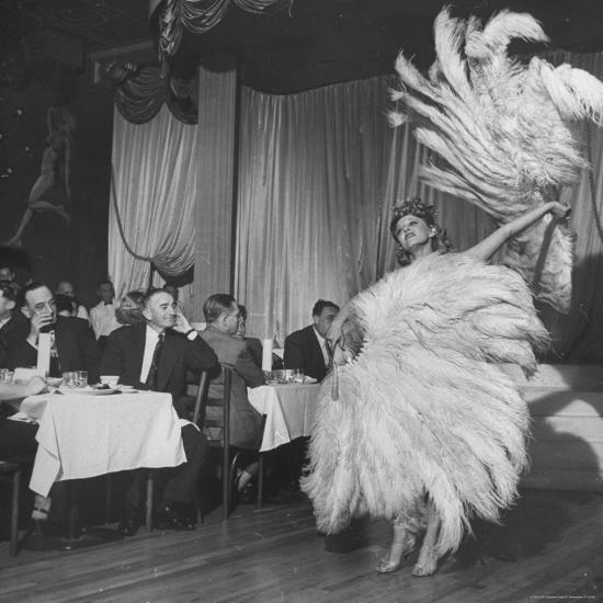 https://imgc.artprintimages.com/img/print/customers-at-sally-rand-s-nightclub-watching-a-dancer-performing-the-midnight-fan-dance_u-l-p472p10.jpg?h=550&w=550