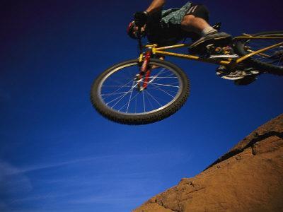 https://imgc.artprintimages.com/img/print/cyclist-jumping-arizona_u-l-p4eefz0.jpg?p=0
