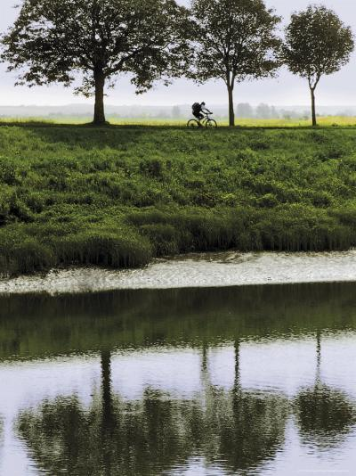 Cyclist on Banks of River Somme, St. Valery Sur Somme, Picardy, France-David Hughes-Photographic Print