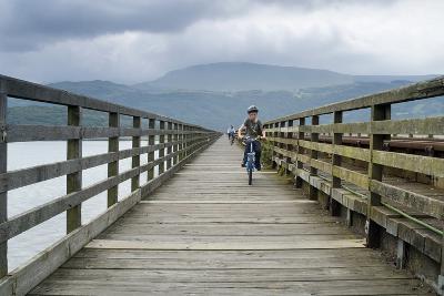 Cyclists on Barmouth Bridge across River Mawddach Estuary, Barmouth, Gwynedd, N.Wales, Uk--Photographic Print