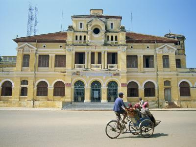 Cyclo Passing the Old Post Office in Phnom Penh in Cambodia, Indochina, Southeast Asia-Tim Hall-Photographic Print