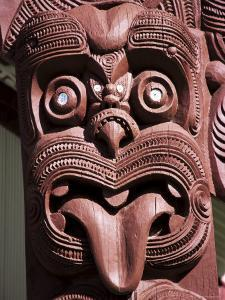 Maori Wooden Carving with Tongue Sticking Out, Rotorua, North Island, New Zealand by D H Webster