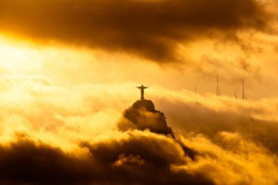 Christ the Redeemer Statue in Clouds on Sunset by dabldy