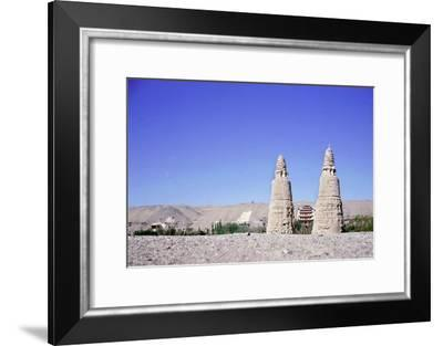 Dagodas near the site of the Mogao Caves, also known as the Thousand Buddha (Quinfodong)-Werner Forman-Framed Giclee Print