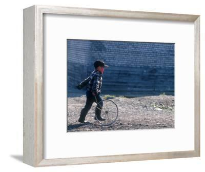 Young Boy Playing on the street of Uelen, Russia's Far East, Siberia