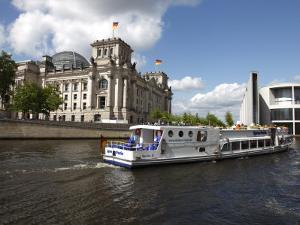 Tour Boat on River Cruise on the Spree River Passing the Reichstag, Berlin, Germany by Dallas & John Heaton