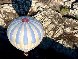 Ballooning Over Lunar Landscape, Cappadocia, Turkey by Dallas Stribley