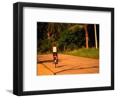 Boy Riding Bike on Dirt Road, Ko Samui, Surat Thani, Thailand