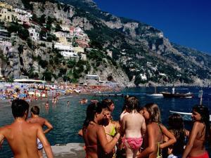 Children at Port, Spiaggia Grande, Positano, Italy by Dallas Stribley