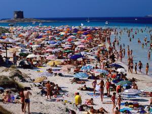 Crowds in Spiaggia Di Pelosa, Stintino, Sardinia, Italy by Dallas Stribley