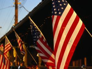 Flags Hanging Outside Diner, Texas, USA by Dallas Stribley