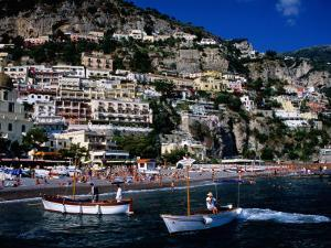 Houses Terraced into Rugged Amalfi Coastline, Boats in Foreground, Positano, Italy by Dallas Stribley