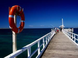 Life Buoy and Fishermen on Pier, Point Lonsdale, Australia by Dallas Stribley