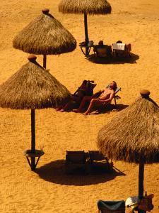 Man Sunbathing on Private Beach of Mt. Lavinia Hotel, Colombo, Sri Lanka by Dallas Stribley
