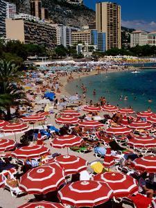 Overhead of Red Sun Umbrellas at Larvotto Beach on Busy Summer's Day, Monte Carlo, Monaco by Dallas Stribley