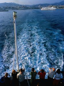 Passengers on Deck of Ferry Travelling from Sardinia to Genova, Sardinia, Italy by Dallas Stribley