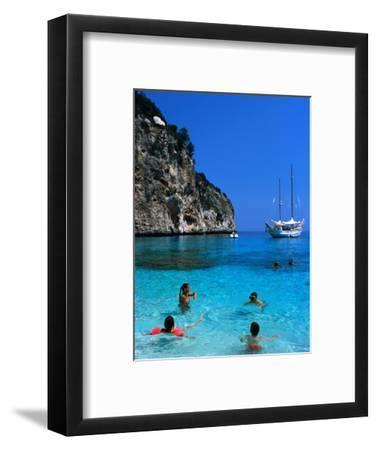 Tourists Swimming in Waters of Cala Mariolu in Gulf of Orosei, Sardinia, Italy