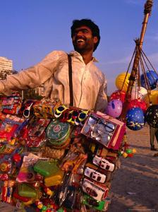 Toy Vendor and Merchandise on Chowpetty Beach, Mumbai, Maharashtra, India by Dallas Stribley