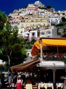Waterfront Restaurant with Steep Terrace of Houses in Background, Positano, Italy by Dallas Stribley