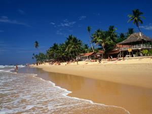 Waves Coming onto Beach and Buildings, Hikkaduwa, Sri Lanka by Dallas Stribley
