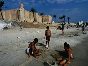 Children Playing on Beach in Front of Restored Fort Ribat, Monastir, Tunisia by Damien Simonis