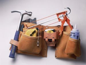 Tool Belt with Hammer, Tape Measure, Caulk Gun by Dan Gair