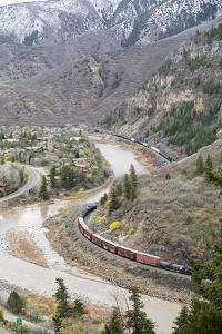 A Train Passes Through The Rocky Mountains In Glenwood Springs, Colorado by Dan Holz
