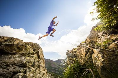 Ben Rueck Catches Some Air During A High Mountain Trail Run Just Outside Marble, CO
