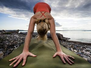 Lisa Eaton Holds a Downward Dog Yoga Pose on the Beach of Lincoln Park - West Seattle, Washington by Dan Holz