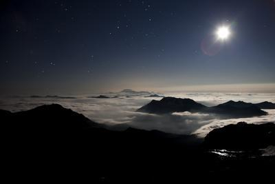 Moon Sand Stars Shine Above Low Lying Clouds on Mount Rainier National Park