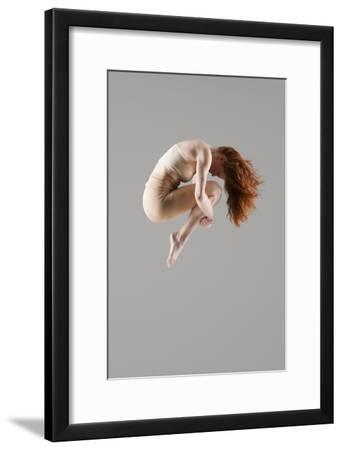 Dancer in Mid-Air with Arms around Knees