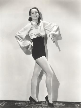 https://imgc.artprintimages.com/img/print/dancer-posing-in-high-waisted-shorts-and-silk-blouse_u-l-q1bvw0t0.jpg?p=0