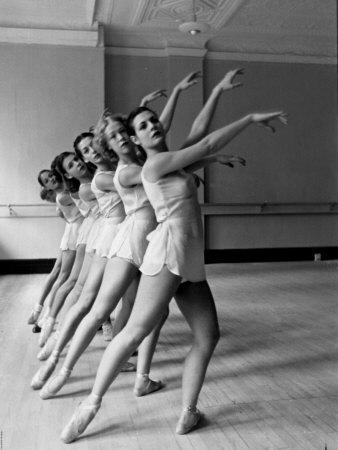 https://imgc.artprintimages.com/img/print/dancers-at-george-balanchine-s-school-of-american-ballet-during-rehearsal-in-dance-posture_u-l-p72t9x0.jpg?artPerspective=n