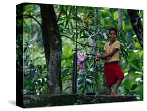 Village Girl at Water Tap, Fiji by Daniel Boag