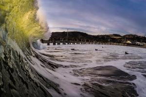 A Clean Up Set Tears Through The Crowd Of Surfers During A Large Swell At Avila Beach, California by Daniel Kuras