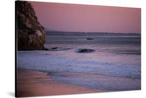 A Lone Wave Breaks Amongst The Pink Sky In Avila Beach, California by Daniel Kuras