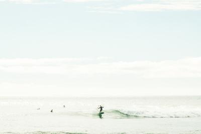 A Surfer Shows Classic Form In His Cutback Somewhere Along California's Coast