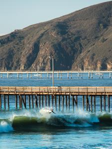 A Surfer Takes To The Air In The Waves Of Avila Beach, Ca by Daniel Kuras