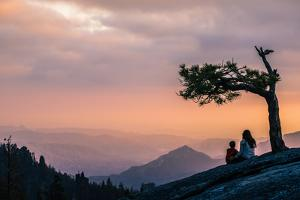 Mother And Son Enjoy Last Light On Beetle Rock In Sequoia National Park by Daniel Kuras