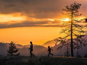 Son Chases His Mom On Beetle Rock In Sequoia National Park As The Sunsets by Daniel Kuras