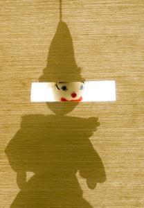 Silhouette of a Sock Puppet Peeking Through a Screen by Daniel Root