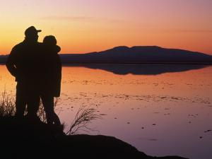 Silhouette of Couple, Turnagain Arm Anchorage, AK by Danny Daniels