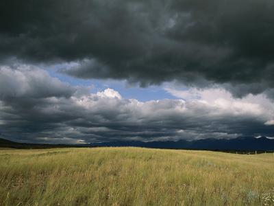 Dark Clouds Gather over a Prairie in the National Bison Range-Annie Griffiths Belt-Photographic Print