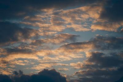 Dark Clouds over a Hilly Landscape at Sunset-Clive Nolan-Photographic Print