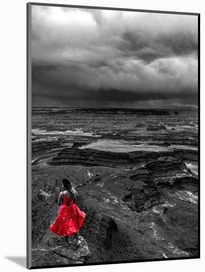 Dark storm clouds over Dead Horse Point State Park with girl in red dress standing near the cliff-David Chang-Mounted Photographic Print