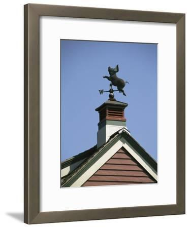 A Flying Pig Weather Vane Atop a Cupola