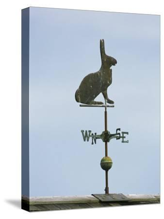 A Rabbit-Shaped Weather Vane Atop a Roof