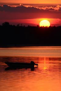 A Silhouetted Boat at Sunset at Cote a Fabien by Darlyne A. Murawski