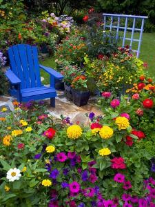 Backyard Flower Garden With Chair by Darrell Gulin
